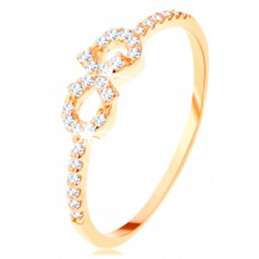 Šperky eshop Prsteň zo žltého 14K zlata - symbol nekonečna zdobený čírymi zirkónikmi - Veľkosť: 50 mm