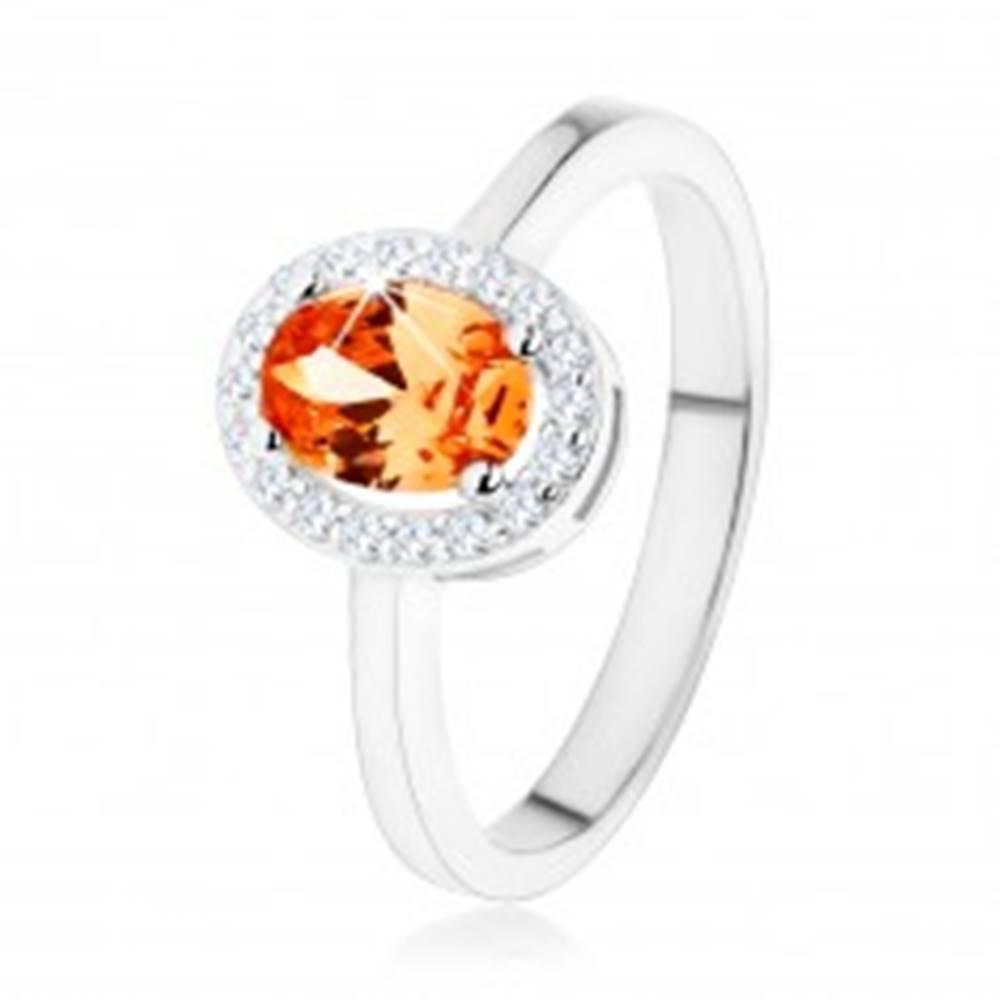 Šperky eshop Strieborný prsteň 925, oranžový oválny zirkón, číry ligotavý lem - Veľkosť: 48 mm