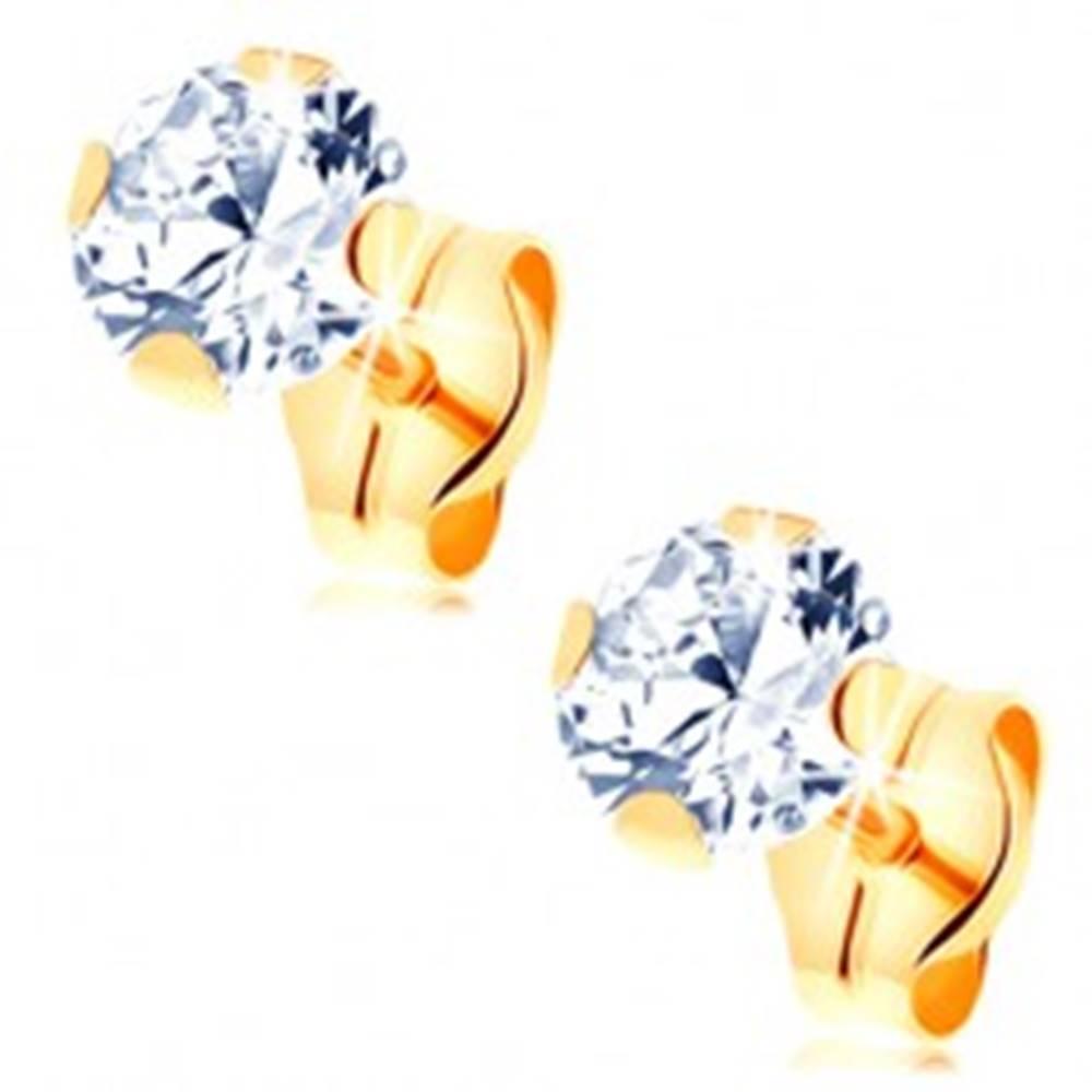 Šperky eshop Náušnice zo žltého 14K zlata - číry okrúhly zirkón v kotlíku, 5 mm