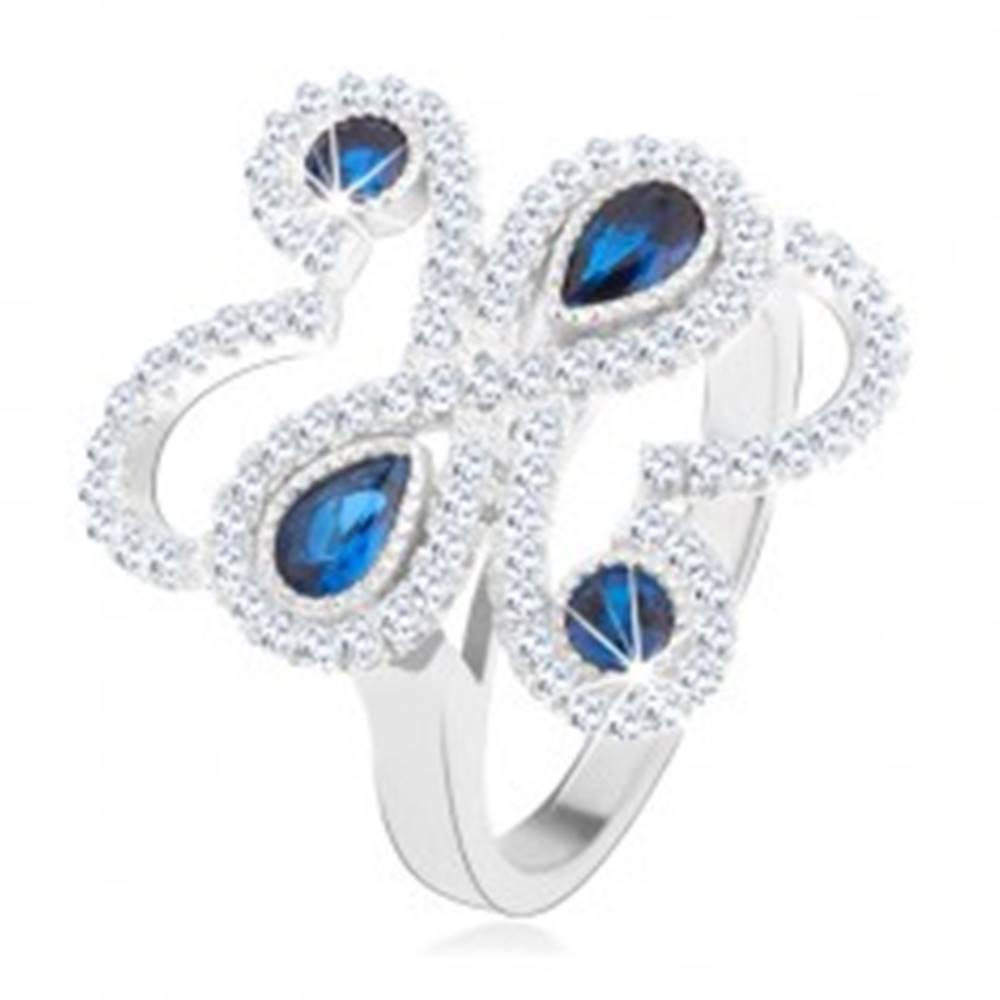 Šperky eshop Prsteň zo striebra 925, ligotavé zvlnené línie, modré zirkóny - Veľkosť: 52 mm